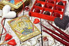Love Magic Ritual With Red Candles, Tarot Card Lovers, Heart Symbols And Chocolate Candies. Stock Images