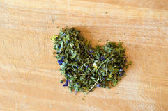 Love for mallow herbal tea. Heart of mallow herbal tea on wood Royalty Free Stock Photography