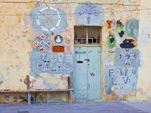 Love Malta... Front Door... Mediterranean Village. The front door of a fishermans house in Malta with Love Malta, For You Love on the walls and various other Royalty Free Stock Photo
