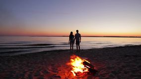 In love man and woman on the island. Honeymoon on the island. Romantic date on the beach. Date of lovers around the campfire. Romance on the island