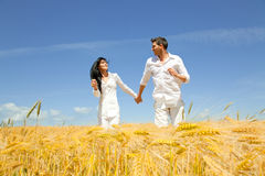 Love man woman running field Royalty Free Stock Photography