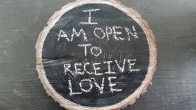 Love mantra. I am open to receive love mantra written on black chalkboard with white chalk Royalty Free Stock Photos