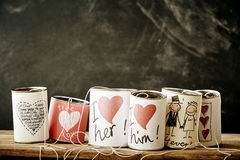 Love and marriage handicrafts on metal cans Royalty Free Stock Images