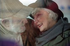 Gentle old female and male are expressing pleasure. Love with me forever. Romantic senior men and women are looking at each other with fondness. They are feeling Royalty Free Stock Photos