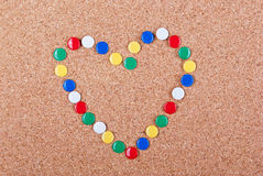 Love me. Heart made of colorful pins Royalty Free Stock Images
