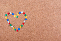Love me. Heart made of colorful pins Stock Photos