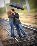 Love me tender 3. A romantic couple on a walk in the rain Stock Images