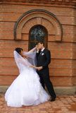 Love meeting. Bride and groom meet at a church court Stock Image