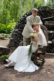 Love meeting. Bride and groom meet at a romantic garden Stock Image