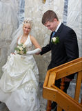 Love meeting. Bride and groom meet at a romantic place Stock Photos