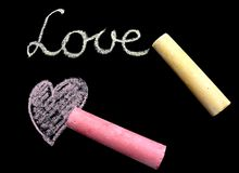Love message. On black board Stock Images