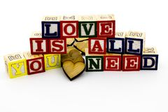 Love message all you need blocks. Love is all you need  family message wood hearts building abc alphabet blocks inspiration quote white background Royalty Free Stock Images