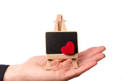 Love message on a blank blackboard Royalty Free Stock Images