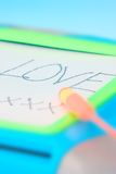 Love message on the board. A love message written on a magnetic toy board Stock Photos