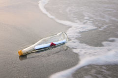 Love message in bottle. Love message in glass bottle on the beach Royalty Free Stock Photo