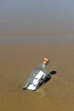 Love message in a bottle on the sand of the beach Stock Photos