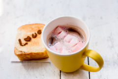 Love message on Bread sliced and chocolate cup and marshmellows Stock Image