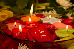 Love message. With candles and the written rose petal Stock Photography