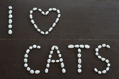 Love message cats. The message I love cats written with white pebble stones Stock Photography