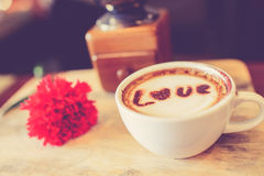 Love message on coffee cup on wood Royalty Free Stock Image