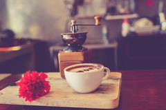 Love message on coffee cup on wood. En background with vintage colour effect. Still life Stock Images