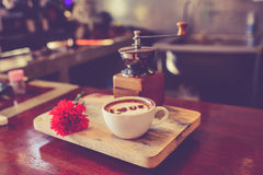 Love message on coffee cup on wood. En background with vintage colour effect. Still life Stock Photos