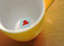 Love message in cup. Love message in yellow cup Stock Photography