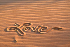 Love message drawn in sand Stock Images