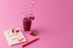 Love message with fresh cherry Stock Image