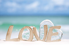 Love message and glass hearts on  beach Stock Image