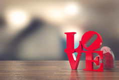 Love message with heart jigsaw and blur background for Valentine`s day. 3D rendering Stock Images