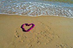 Love Message. A heart shaped love message in the sand Royalty Free Stock Image