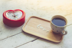 Love message by icing powder with coffee cup Royalty Free Stock Image