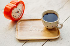 Love message by icing powder with coffee cup Royalty Free Stock Images