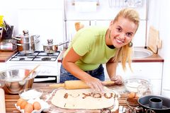 Love message in the kitchen. Love message written by a smiling girl in the kitchen Royalty Free Stock Photo