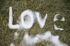 Love. Message made of snow. Royalty Free Stock Images