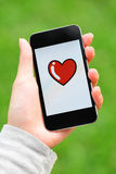 Love message on mobile phone screen Royalty Free Stock Photo