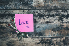 Love message on pink note Royalty Free Stock Images