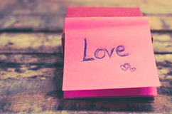 Love message on pink note Stock Image