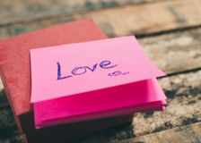 Love message on pink note Stock Images