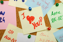 Love message pinned on cork board Stock Image