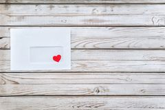 Love message. Red heart in a white envelope. A letter about love Stock Photo