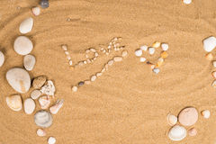 Love message on sand stock image