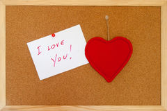 I love you. Love message on a sheet on the bulletin board Royalty Free Stock Photography