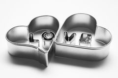 Love message in two hearts. Made of chrome letters Stock Images
