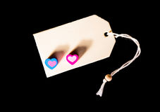 Love message. Two little hearts with copy space on black Stock Image