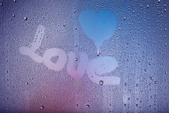 Love message on a window. Background Royalty Free Stock Photo