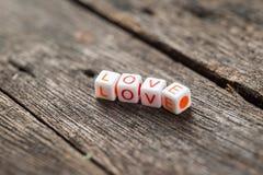 Love message written in  blocks Stock Photos