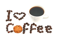 Love message written with coffee beans and cookie. Coffee cup and message written with coffee beans Stock Photos