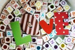 Love message written over  letter blocks Stock Images